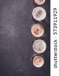 beer glasses on dark table | Shutterstock . vector #573911929