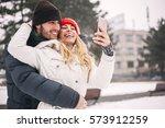 happy couple taking selfie by... | Shutterstock . vector #573912259