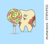 tooth with a candy and decay or ... | Shutterstock .eps vector #573919531