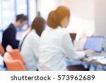 abstract blurred employee work... | Shutterstock . vector #573962689
