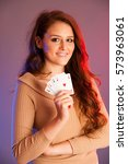 beautiful brunette holding four ... | Shutterstock . vector #573963061