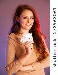 beautiful brunette holding four ... | Shutterstock . vector #573963061