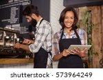 waitress using a tablet...   Shutterstock . vector #573964249