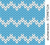 knitted baby blue and white... | Shutterstock .eps vector #573987124