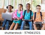 portrait of kids using a laptop ... | Shutterstock . vector #574061521