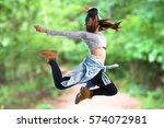 girl jumping in hip hop style... | Shutterstock . vector #574072981