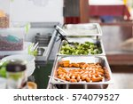 Stock photo fresh meal in lunch service station at school cafeteria 574079527