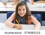 portrait of smiling schoolgirl... | Shutterstock . vector #574085131