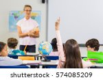 pupil with hands up during... | Shutterstock . vector #574085209