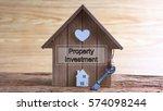 conceptual image of miniature... | Shutterstock . vector #574098244