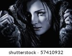 High fashion female model beauty shoot with fur jacket. Night shot. retouched by professional retoucher. - stock photo