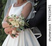 bride holds a wedding bouquet... | Shutterstock . vector #574113451