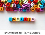 Small photo of colorful english word cube on white paper background ,English language learning concept