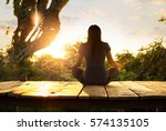 woman practicing meditation... | Shutterstock . vector #574135105
