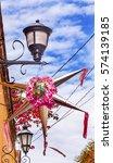Small photo of Pink Christmas Pinata Decoration Street Lamps Bougainvillea Aldama Street San Miiguel de Allende Mexico