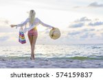 blonde woman on the beach at... | Shutterstock . vector #574159837