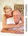 couple relaxing in bedroom   Shutterstock . vector #57416002