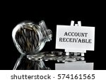 Small photo of Business Concept - Money in glass containe and white board written Account Receivable
