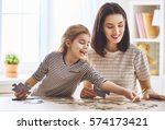 happy family. mother and... | Shutterstock . vector #574173421