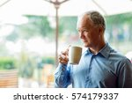 closeup of pensive middle aged... | Shutterstock . vector #574179337