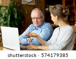 two people discussing business... | Shutterstock . vector #574179385