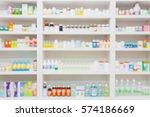 medicines arranged on shelves... | Shutterstock . vector #574186669