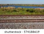 railway lake and field | Shutterstock . vector #574188619