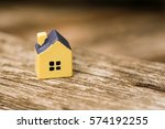 miniature yellow toy house on a ...   Shutterstock . vector #574192255