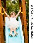 little girl enjoys playing on a ...   Shutterstock . vector #574197145