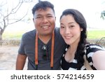 selfie couple making selfie on... | Shutterstock . vector #574214659