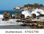 Bay in Puerto Escondido with hotel and lighthouse, Mexico - stock photo