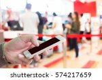 man use mobile phone  blur... | Shutterstock . vector #574217659