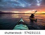 Stock photo kayakers enjoying the beautiful sunrise picture taken near kitsilano beach vancouver bc canada 574231111