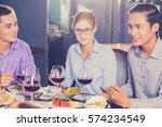 business partners having dinner ... | Shutterstock . vector #574234549