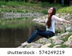girl on the rock river | Shutterstock . vector #574249219