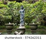 A Stone Statue In A Calm Lily...