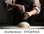 man sprinkling flour over fresh ... | Shutterstock . vector #574269415