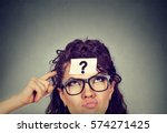 thinking perplexed woman with... | Shutterstock . vector #574271425