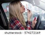 young woman putting on lip... | Shutterstock . vector #574272169