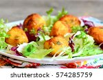fried potato balls with salad... | Shutterstock . vector #574285759