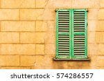 old green window shutters with... | Shutterstock . vector #574286557