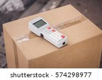 parcel with barcode scanner | Shutterstock . vector #574298977