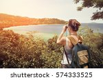 happy woman tourist with... | Shutterstock . vector #574333525