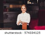 young business woman smiling... | Shutterstock . vector #574334125