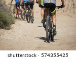 active group on a bike ride in... | Shutterstock . vector #574355425