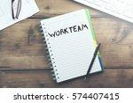work team text on notebook...   Shutterstock . vector #574407415