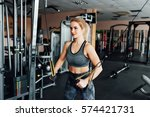 athletic young woman doing... | Shutterstock . vector #574421731