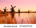 Stock photo pink sunset panoramic view of windmills in zaanse schans traditional village in holland 574437919