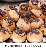 chocolate eclairs on metal...   Shutterstock . vector #574447021