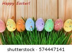 easter eggs in green grass on a ... | Shutterstock . vector #574447141